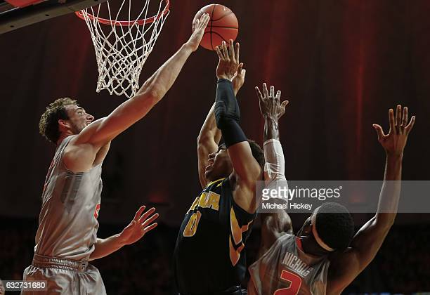 Maverick Morgan of the Illinois Fighting Illini blocks the shot of Ahmad Wagner of the Iowa Hawkeyes at State Farm Center on January 25 2017 in...