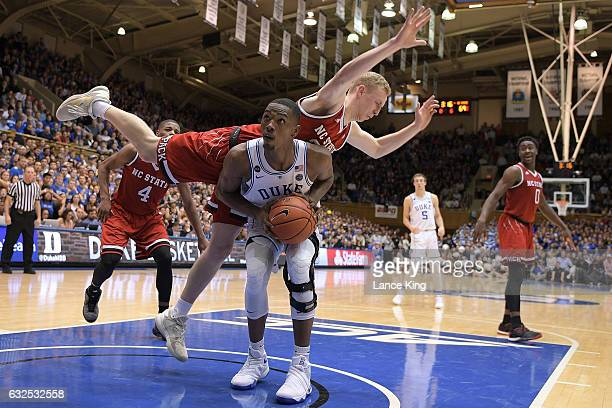 Maverick Rowan of the North Carolina State Wolfpack fouls Harry Giles of the Duke Blue Devils at Cameron Indoor Stadium on January 23 2017 in Durham...