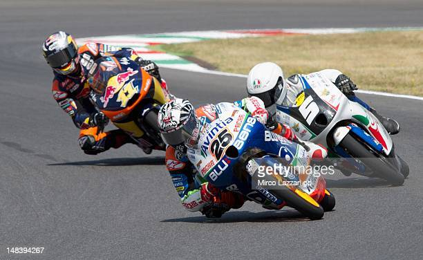 Maverick Vinales of Spain and Avintia Racing Moto3 leads other riders during the Moto3 race of the MotoGP of Italy at Mugello Circuit on July 15 2012...