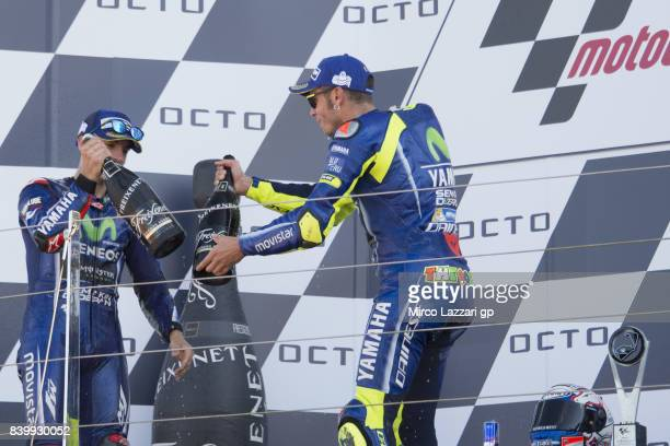 Maverick Vinales of Spain and Movistar Yamaha MotoGP and Valentino Rossi of Italy and Movistar Yamaha MotoGP celebrate on the podium at the end of...