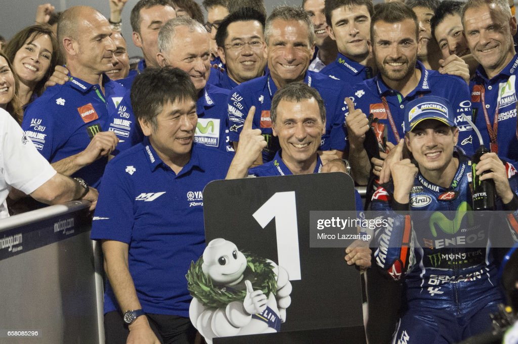Maverick Vinales of Spain and Movistar Yamaha MotoGP celebrates the victory with team under the podium at the end of the MotoGP race during the MotoGp of Qatar - Race at Losail Circuit on March 26, 2017 in Doha, Qatar.