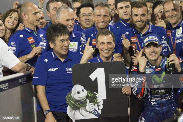 Maverick Vinales of Spain and Movistar Yamaha MotoGP celebrates the victory with team under the podium at the end of the MotoGP race during the...