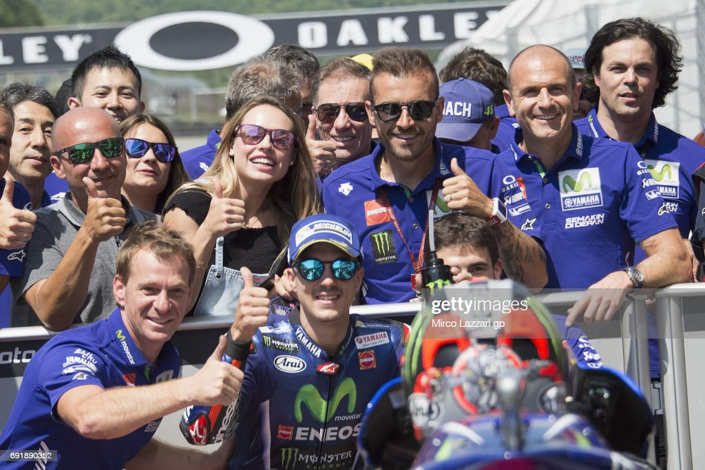 Maverick Vinales of Spain and Movistar Yamaha MotoGP celebrates with team the pole position at the end of the qualifying practice during the MotoGp of Italy - Qualifying at Mugello Circuit on June 3, 2017 in Scarperia, Italy.