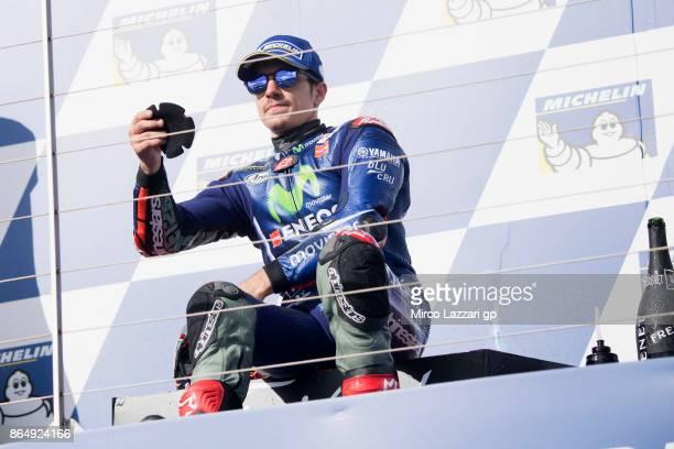 Maverick Vinales of Spain and Movistar Yamaha MotoGP gives the slade at fans on the podium at the end of the MotoGP race during the 2017 MotoGP of...