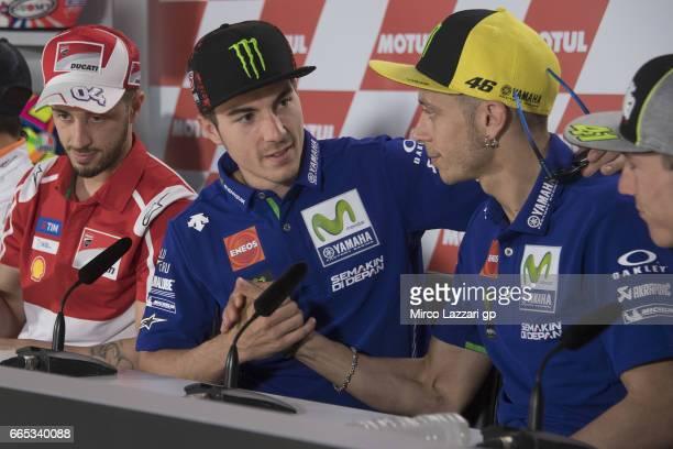 Maverick Vinales of Spain and Movistar Yamaha MotoGP greets Valentino Rossi of Italy and Movistar Yamaha MotoGP during the MotoGp of Argentina...