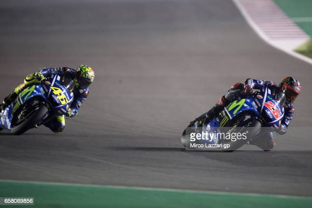 Maverick Vinales of Spain and Movistar Yamaha MotoGP leads Valentino Rossi of Italy and Movistar Yamaha MotoGP during the MotoGP race during the...