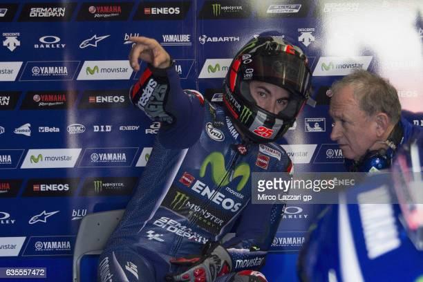 Maverick Vinales of Spain and Movistar Yamaha MotoGP speaks in box with mechanic during 2017 MotoGP preseason testing at Phillip Island Grand Prix...