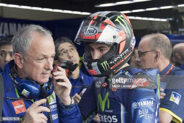 Maverick Vinales of Spain and Movistar Yamaha MotoGP speaks with mechanics in box during the MotoGp of Argentina Qualifying on April 8 2017 in Rio...