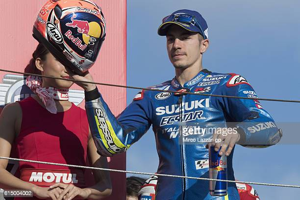 Maverick Vinales of Spain and Team Suzuki ECSTAR celebrates on the podium the third place at the end of the MotoGP race during the MotoGP of Japan...
