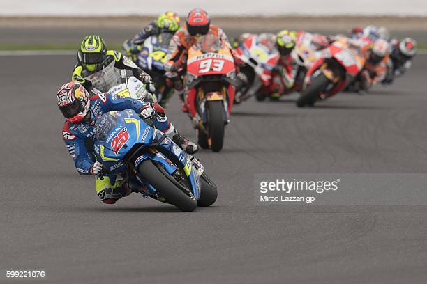 Maverick Vinales of Spain and Team Suzuki ECSTAR leads the field during the MotoGP race during the MotoGp Of Great Britain Race at Silverstone...