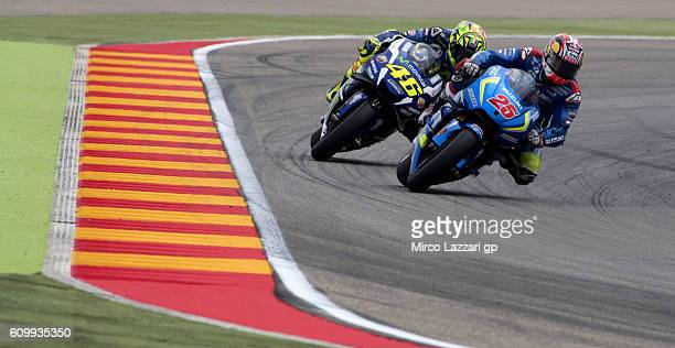 Maverick Vinales of Spain and Team Suzuki ECSTAR leads Valentino Rossi of Italy and Movistar Yamaha MotoGP during the MotoGP of Spain Free Practice...