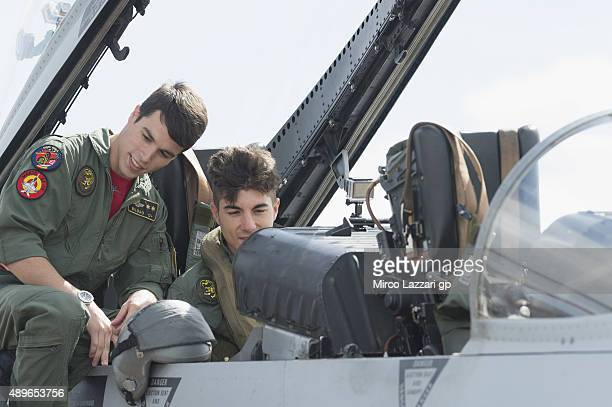 Maverick Vinales of Spain and Team Suzuki MotoGP emulates his namesake from 'Top Gun' during the PreEvent at the Zaragoza Military Air Base during...