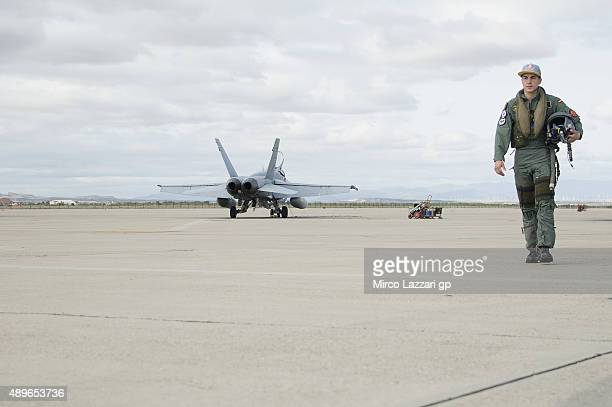 Maverick Vinales of Spain and Team Suzuki MotoGP walks near the fighter plane and emulates his namesake from 'Top Gun' during the PreEvent at the...