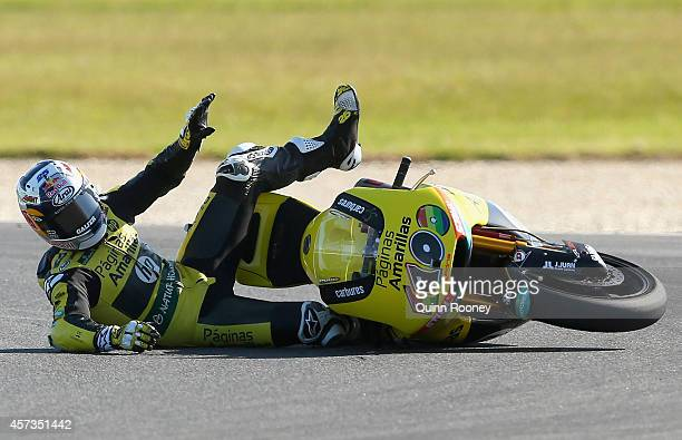 Maverick Vinales of Spain comes off his Paginas Amarillas HP 40 Kalex bike during Moto2 free practice for the 2014 MotoGP of Australia at Phillip...