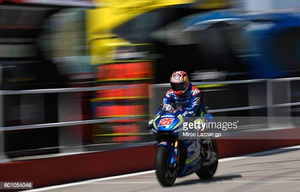 Maverick Vinales of Team SUZUKI ECSTAR makes his way back to his box during MotoGP of San Marino Free Practice at Misano World Circuit on September 9...
