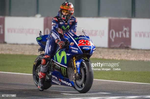 Maverick Vinales who rides Yamaha for Movistar Yamaha MotoGP waitngon the start grid for the Grand Prix of Qatar at the Losail International Circuit...