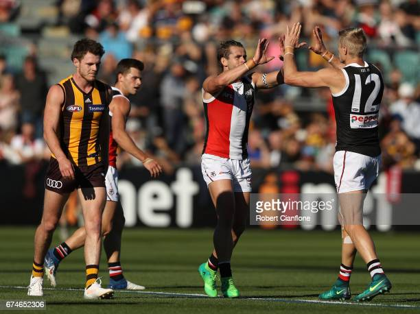Maverick Weller of the Saints celebrates with Nick Riewoldt after scoring a goal during the round six AFL match between the Hawthorn Hawks and the St...
