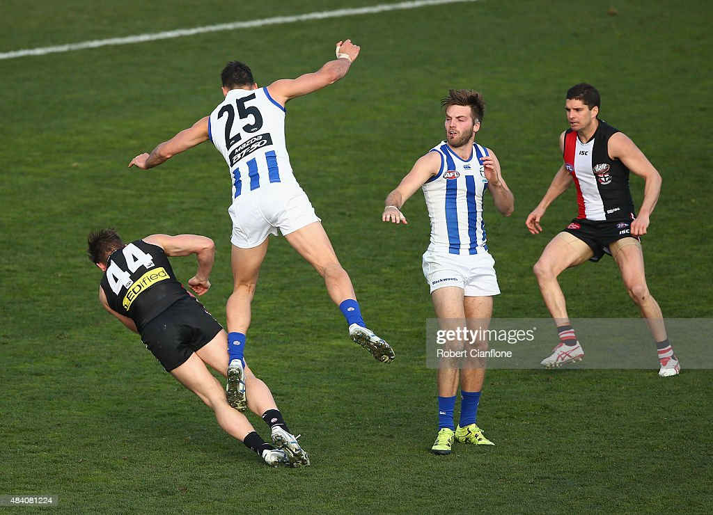 Maverick Weller of the Saints collides with Robbie Tarrant of the Kangaroos during the round 20 AFL match between the North Melbourne Kangaroos and the St Kilda Saints at Blundstone Arena on August 15, 2015 in Hobart, Australia.