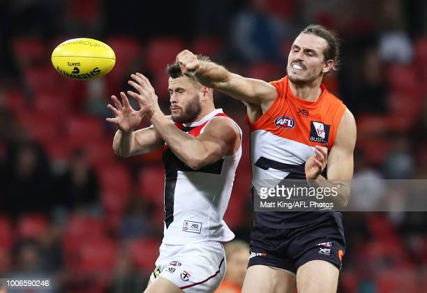 Maverick Weller of the Saints competes for the ball against Phil Davis of the Giants during the round 19 AFL match between the Greater Western Sydney...