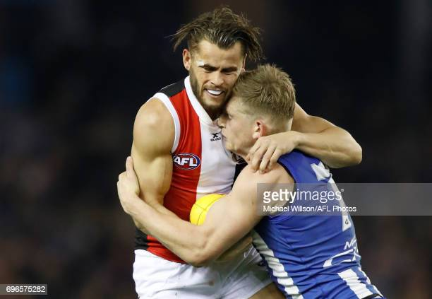Maverick Weller of the Saints is tackled by Jack Ziebell of the Kangaroos during the 2017 AFL round 13 match between the North Melbourne Kangaroos...