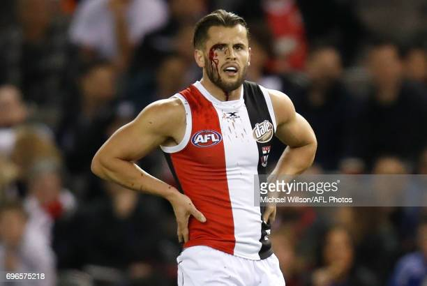 Maverick Weller of the Saints looks on with a bloodied eye during the 2017 AFL round 13 match between the North Melbourne Kangaroos and the St Kilda...