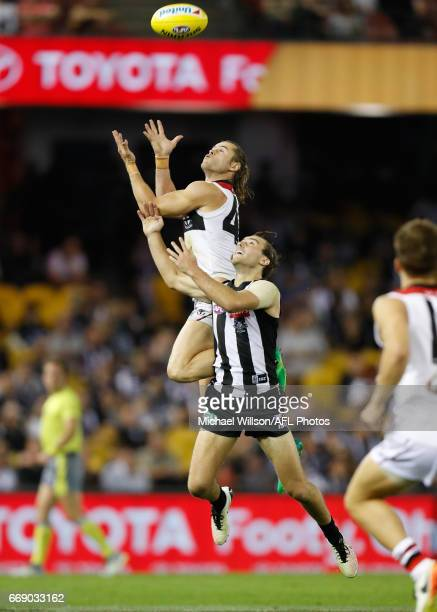 Maverick Weller of the Saints marks the ball over Tim Broomhead of the Magpies during the 2017 AFL round 04 match between the Collingwood Magpies and...