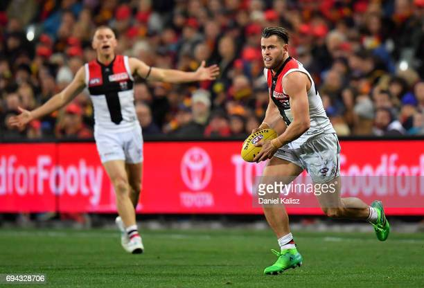 Maverick Weller of the Saints runs with the ball during the round 12 AFL match between the Adelaide Crows and the St Kilda Saints at Adelaide Oval on...