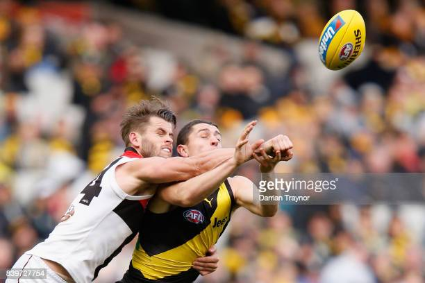Maverick Weller of the Saints spoils Oleg Markov of the Tigers during the round 23 AFL match between the Richmond Tigers and the St Kilda Saints at...