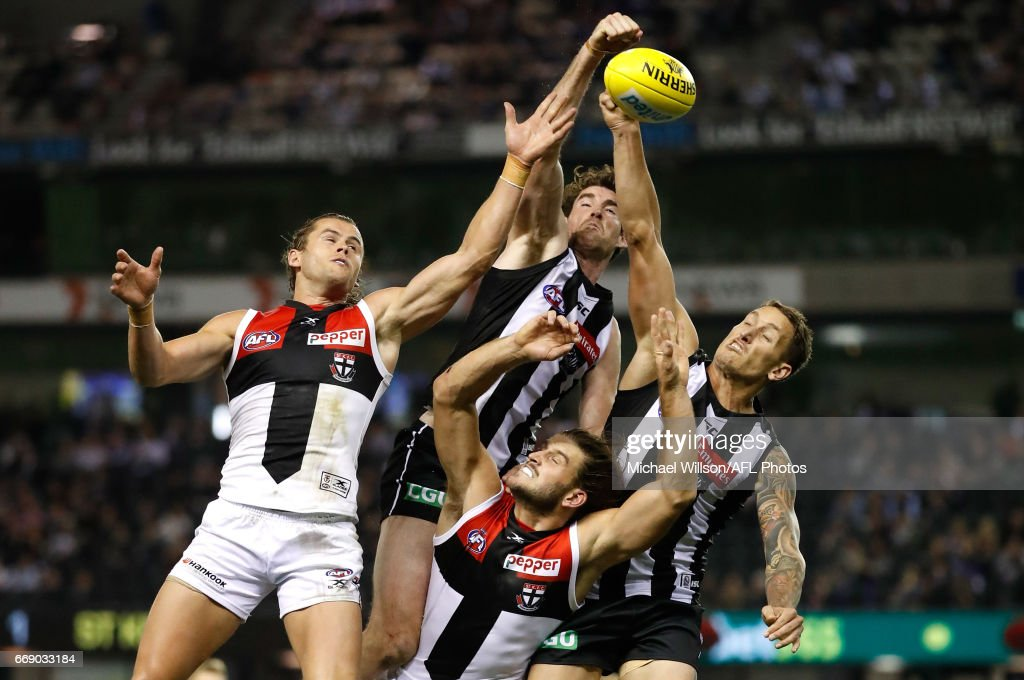 Maverick Weller of the Saints, Tyson Goldsack of the Magpies, Josh Bruce of the Saints and Jesse White of the Magpies compete for the ball during the 2017 AFL round 04 match between the Collingwood Magpies and the St Kilda Saints at Etihad Stadium on April 16, 2017 in Melbourne, Australia.