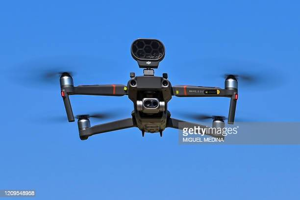 Mavic 2 Enterprise drone equipped with a thermal sensor used by municipal police in Treviolo for checking people's temperature is pictured in flight...