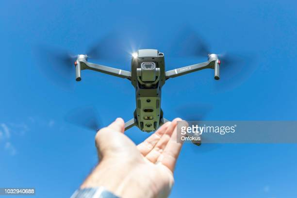 dji mavic 2 pro drone featuring a new 1 inch cmos sensor and hasselblad 20 megapixels camera - landing touching down stock pictures, royalty-free photos & images