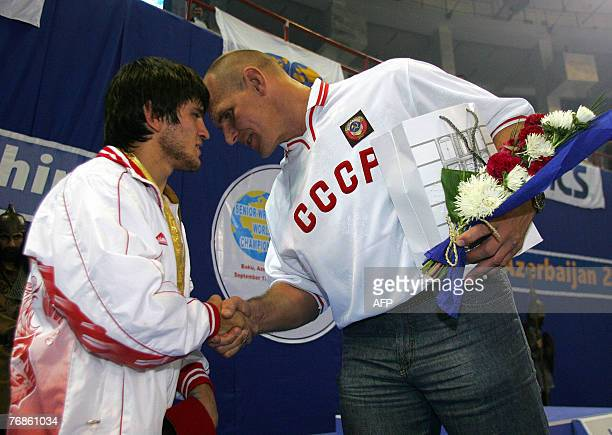 Maviet Batirov of Russia is congratulated by Russian wrestling legend Alexander Karelin in Baku 19 September 2007 Baku the capital city of Azerbaijan...