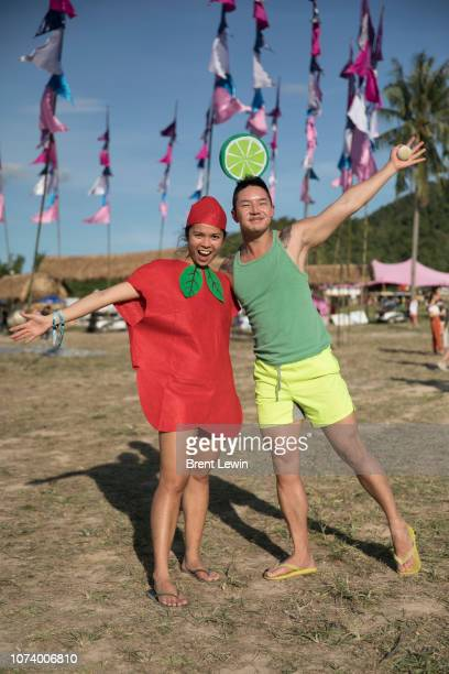 Mavis And dressed as an apple and Abel Koh dressed as a lime at Wonderfruit 2018 on December 15 2018 in Pattaya Thailand