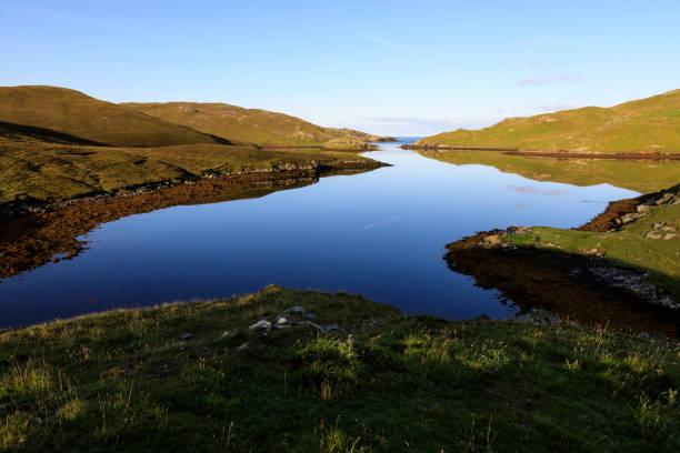 Mavis Grind, early morning reflections, narrow isthmus between North Sea and Atlantic Ocean, Shetland Isles, Scotland, United Kingdom, Europe, Europe