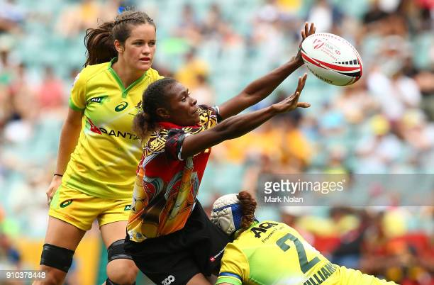 Mavis MItaharo of PNG offloads in the womens pool match between Australia and Papua New Guinea during day one of the 2018 Sydney Sevens at Allianz...