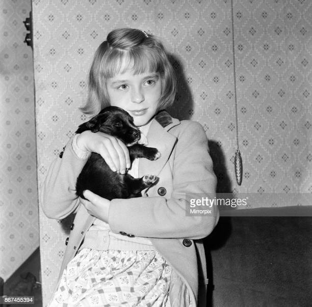 Mavis Ogden, aged 9 of Rochdale, with her new puppy - a gift from Mrs Chesworth of Huddersfield, 6th July 1958.
