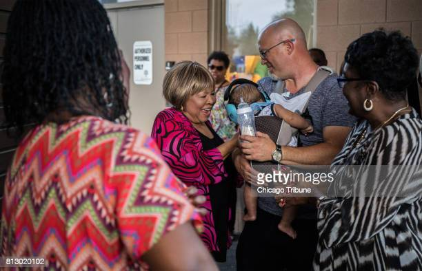 Mavis Staples center rhythm and blues and gospel singer visits with Chicago blues singer Shemekia Copeland left and her son Johnny Lee...