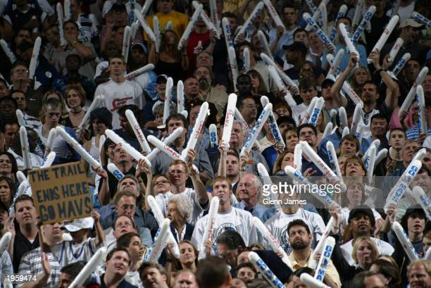 Mavs fans make some noise with their thunder sticks as the Dallas Mavericks host the Portland Trail Blazers in Game one of the Western Conference...