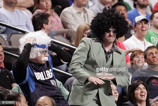 Mavs fans wearing afro wigs celebrate on the stands during the game between the Los Angeles Clippers and the Dallas Mavericks at the American...