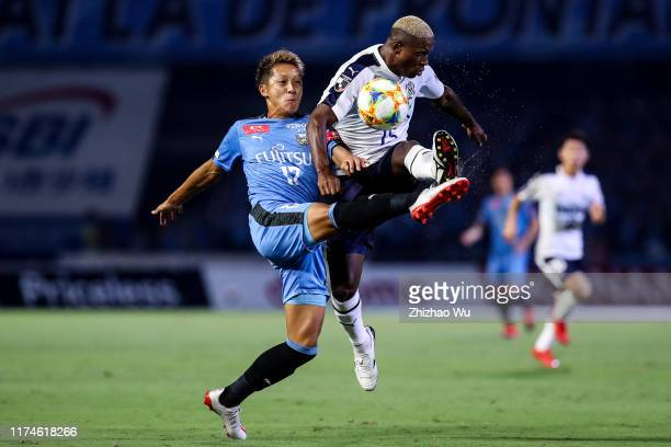 Mawatari Kazuaki of Kawasaki Frontale competes for the ball with Adailton of Jubilo Iwata during the J.League J1 match between Kawasaki Frontale and...