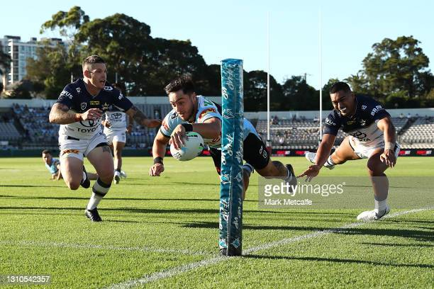 Mawene Hiroti of the Sharks scores a try during the round four NRL match between the Cronulla Sharks and the North Queensland Cowboys at Netstrata...