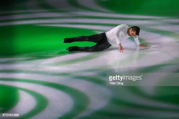 Max Aaron of the United States falls on the ice when performing during exhibition program of Audi Cup of China ISU Grand Prix of Figure Skating 2017...