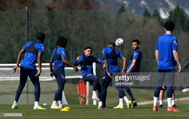 Max Aarons, Lloyd Kelly of England and teammates compete for the ball during an England Under-21 Training Session at NNC Brdo on March 30, 2021 in...