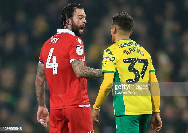 Max Aarons of Norwich City and Danny Fox of Nottingham Forest clash during the Sky Bet Championship match between Norwich City and Nottingham Forest...