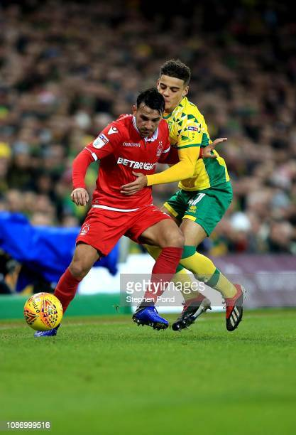 Max Aarons of Norwich City and Joao Carvalho of Nottingham Forest compete for the ball during the Sky Bet Championship match between Norwich City and...