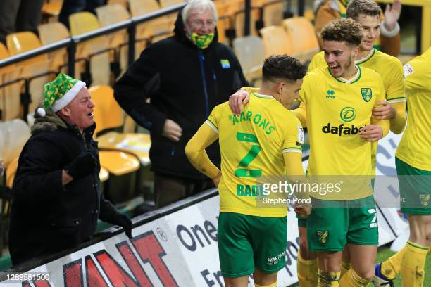 Max Aarons of Norwich City celebrates scoring his sides second goal with a fan during the Sky Bet Championship match between Norwich City and...