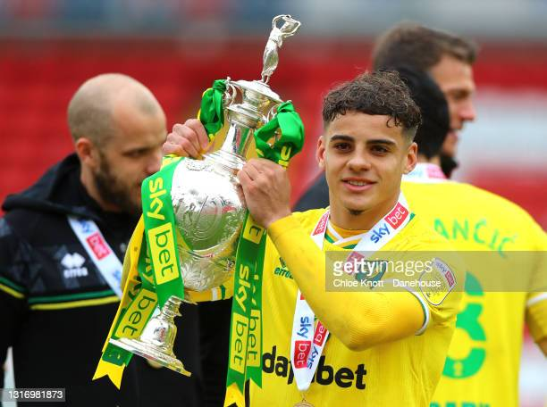 Max Aarons of Norwich City holds the Sky Bet Championship trophy during the Sky Bet Championship match between Barnsley and Norwich City at Oakwell...