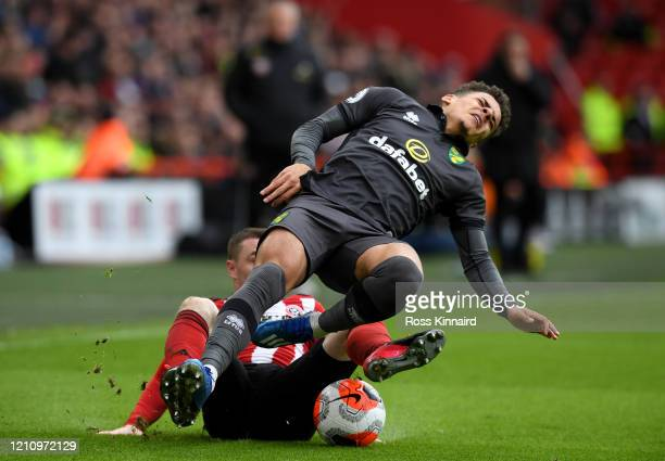 Max Aarons of Norwich City is fouled by Ozan Kabak of FC Schalke 04 during the Premier League match between Sheffield United and Norwich City at...