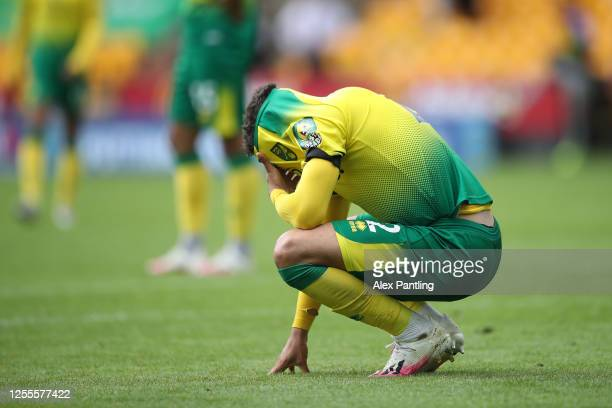 Max Aarons of Norwich City reacts at full time upon his team's relegation following the Premier League match between Norwich City and West Ham United...