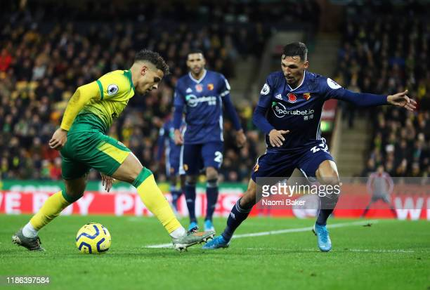 Max Aarons of Norwich tackles with Jose Holebas of Watford during the Premier League match between Norwich City and Watford FC at Carrow Road on...